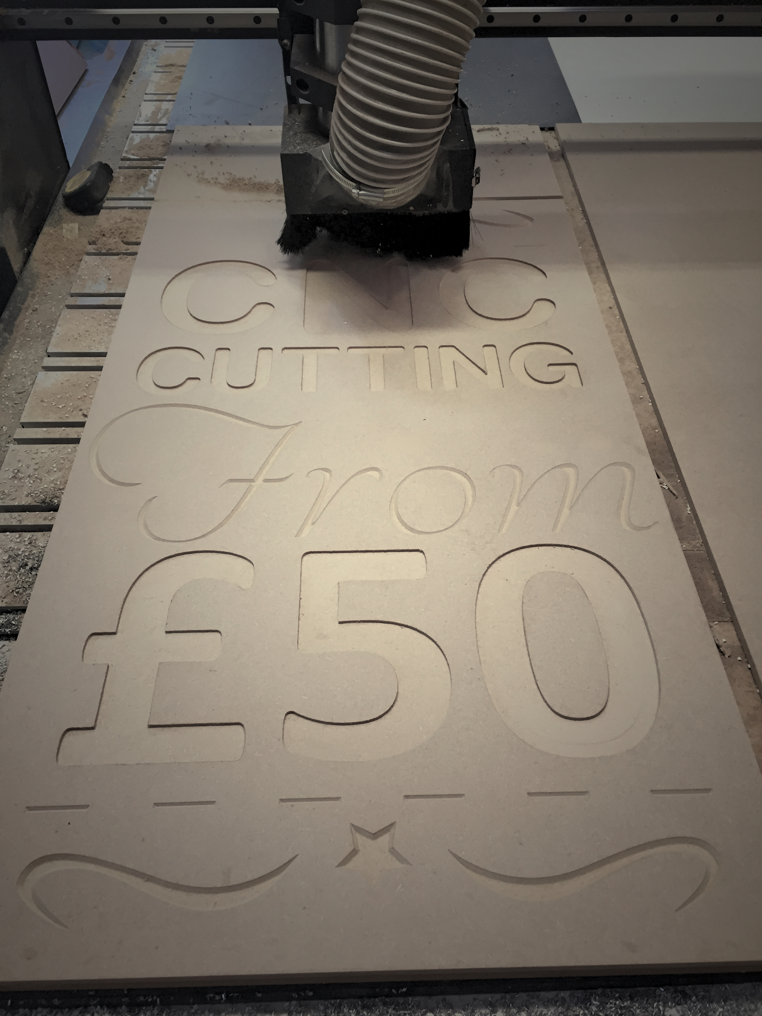 Photo of sign being cut by CNC router