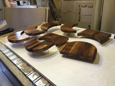 photo of cnc cut iroko benches