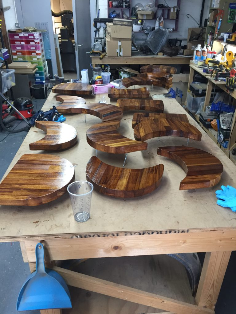 photo of cnc cut iroko benches