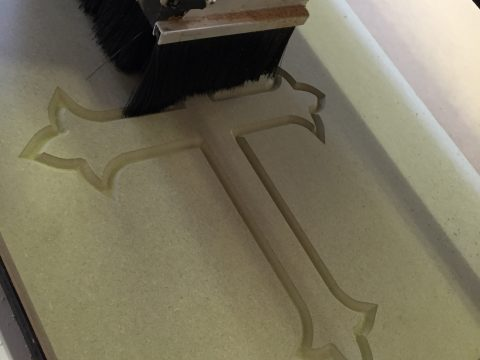 PHOTO OF CNC ROUTER CUTTING MDF CROSS